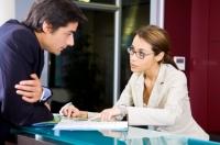 Travel agent advising client