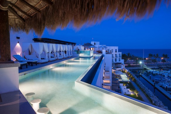 El Ganzo has a rooftop swim up bar.